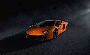 Фотографии Lamborghini Оранжевый Дорогие Aventador LP700-4 Авто