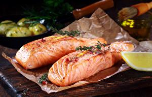 Фото Морепродукты Рыба Лимоны Продукты питания