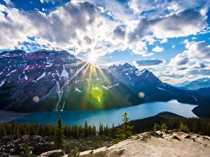 Фотография Пейзаж Канада Парки Горы Озеро Банф Облачно Лучи света Природа
