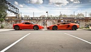Картинки Lamborghini Феррари Оранжевый Двое aventador lp700-4 italia 458 Авто