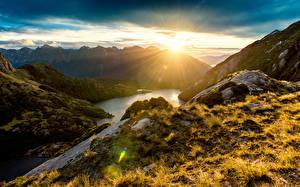 Обои Новая Зеландия Пейзаж Горы Рассветы и закаты Реки Fiordland Природа