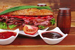 Фотография Быстрое питание Гамбургер Ветчина Помидоры Кетчупа