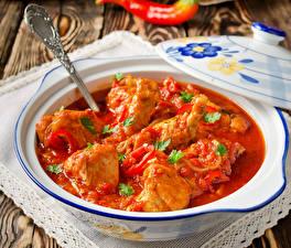 Фотографии Мясные продукты Курица Кетчупом Тарелка Ложки Еда