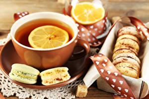 Картинка Лимоны Чай Печенье Чашка Макарон Еда