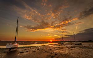 Фотография Рассветы и закаты Море Лодки Небо Облака Природа