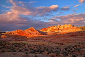 Картинка Рассветы и закаты Горы Небо Утес Облака Природа