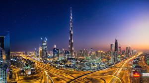 Фотографии ОАЭ Дубай Небоскребы Здания Ночные Мегаполис Скорость Города