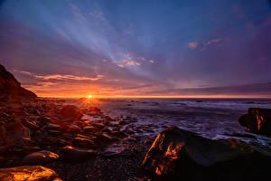 Обои Рассветы и закаты Новая Зеландия Камни Небо Пейзаж Солнца Горизонт Природа