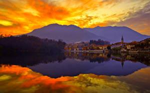Обои Рассвет и закат Озеро Горы Природа Города