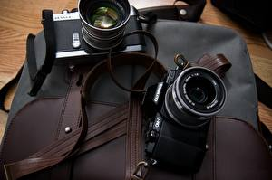 Обои Крупным планом Фотоаппарат Двое Olympus OMD EM10 фото
