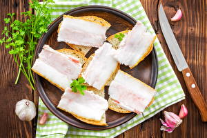 Обои Мясные продукты Чеснок Нож Сало Еда