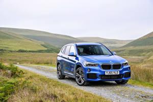 Обои для рабочего стола BMW Голубые Металлик Траве 2015 X1 20d xDrive M Sport машины