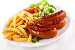 Фотография Вторые блюда Сосиска Картофель фри Овощи Еда