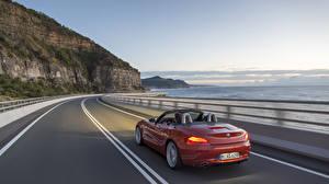Фотография BMW BMW Z4 Дороги Берег Скорость Кабриолета Бордовый машины