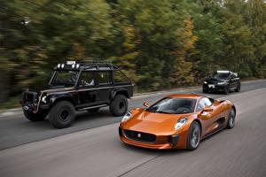 Картинка Ягуар Оранжевый Втроем Металлик Едущая 2015 C-X75 Spectre машины