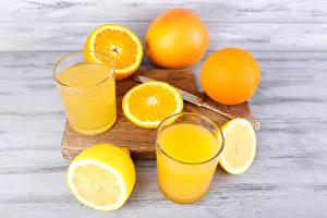 Фотографии Напитки Сок Апельсин Лимоны Стакан Двое Еда