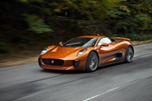 Фотография Jaguar Оранжевый Металлик Едущий 2015 C-X75 Spectre Автомобили