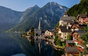 Картинка Австрия Озеро Горы Пейзаж Побережье Дома Халльштатт Альпы Природа