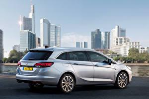 Картинки Vauxhall Здания Серебряная Сзади 2015 Astra Sports Tourer
