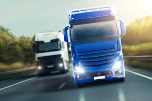 Фотографии Грузовики Синий Белый Двое Фары Спереди Автомобили