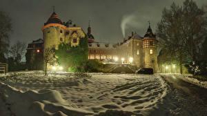 Картинки Германия Замки Зимние Ночь Снег Уличные фонари Laubach Castle город