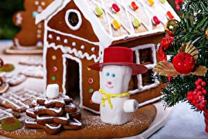 Фото Праздники Новый год Выпечка Здания Печенье Пряничный домик Снеговики Еда
