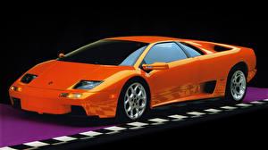 Обои Ламборгини Оранжевая Diablo VT supercar автомобиль