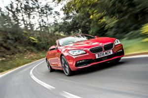 Картинка BMW Кабриолета Красный Едущая 2015 Cabrio 650i UK-spec F12 Автомобили