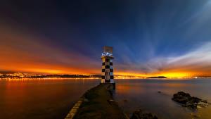 Фото Новая Зеландия Маяк Рассвет и закат Ночь Wellington Природа