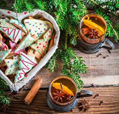 Фотографии Праздники Рождество Выпечка Печенье Чай Стакане Ветка Еда