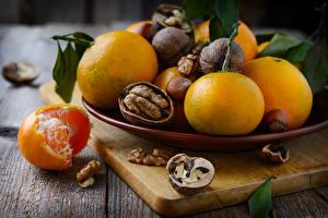 Фото Цитрусовые Мандарины Орехи Пища