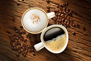 Картинки Напитки Кофе Капучино Чашке Зерна Двое Еда