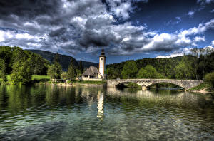 Фотография Словения Озеро Мосты Горы Лес Небо HDR Облачно Bohinj Природа
