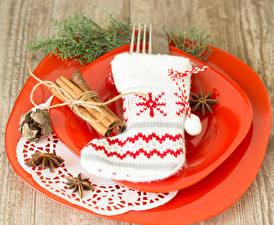Обои Праздники Новый год Корица Бадьян звезда аниса Тарелка Сапоги Носки