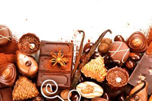 Картинка Сладости Конфеты Шоколад Крупным планом Продукты питания