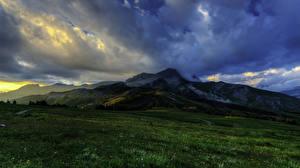 Фото Франция Горы Пейзаж Луга Облака Альпы Природа