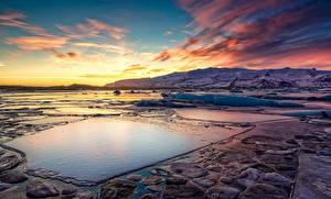 Фотографии Исландия Зима Рассветы и закаты Небо Пейзаж Снег Jokulsarlon Природа