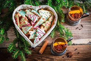 Обои Праздники Новый год Выпечка Печенье Чай Корица Ветки Стакан Сердце Еда фото