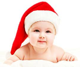 Фотографии Рождество Шапки Грудной ребёнок Смотрит Лицо Ребёнок