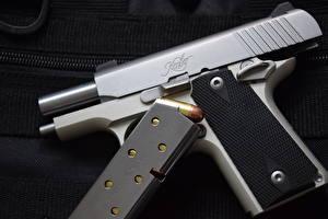 Обои Пистолеты Крупным планом Патроны Kimber Micro 380 Армия фото