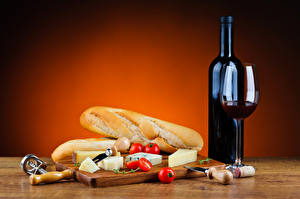 Фотографии Хлеб Сыры Томаты Вино Бутылка Бокалы Продукты питания