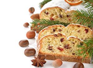 Обои Праздники Новый год Выпечка Орехи Кекс Изюм Ветки Еда фото