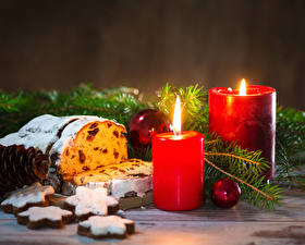 Обои Праздники Новый год Выпечка Свечи Печенье Кекс Изюм Ветки Еда фото