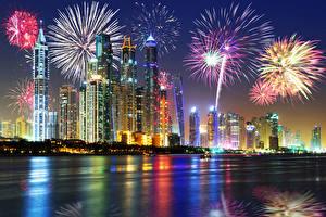 Фотографии Объединённые Арабские Эмираты Дубай Небоскребы Небо Фейерверк Праздники Рождество Ночь Города