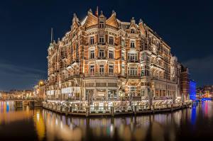 Фотографии Нидерланды Дома Амстердам Отель Водный канал Ночные Hotel De L'Europe Города