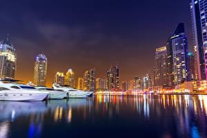 Картинка Дубай ОАЭ Небоскребы Яхта Ночь Города