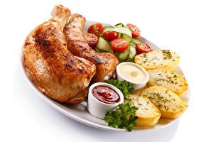 Фотографии Курица запеченная Овощи Картошка Кетчуп Продукты питания