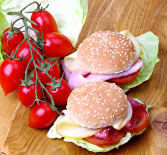 Обои для рабочего стола Бутерброд Булочки Помидоры Гамбургер Фастфуд 2 Еда