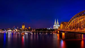 Картинки Германия Речка Мосты Здания Кёльн Ночь Города