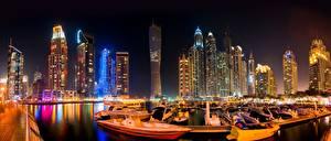 Картинки Дубай Небоскребы ОАЭ Лодки Ночные Города